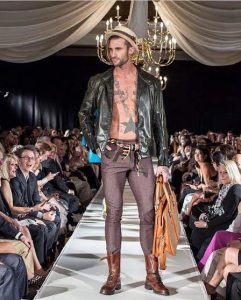 Blake Russell modeling at Charlotte Seen Fashion Show in Charlotte, NC