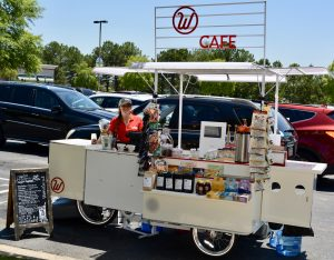 Employee, Carly, sets up the iconic cart at The Landings